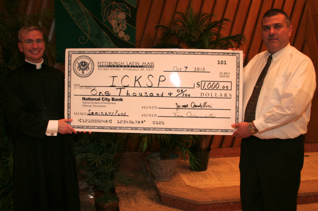 PLMC Vice President Jim Cardellini presenting Canon Matthew Talarico with a $1000 donation from the PLMC Seminary fund to the Institute of Christ the King Sovereign Priest.