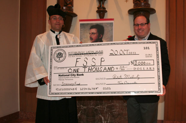 PLMC Treasurer Mr. Tom Oxenreiter presenting Fr. Gregory Pendergraft, FSSP with a $1000 donation from the PLMC Seminary Fund