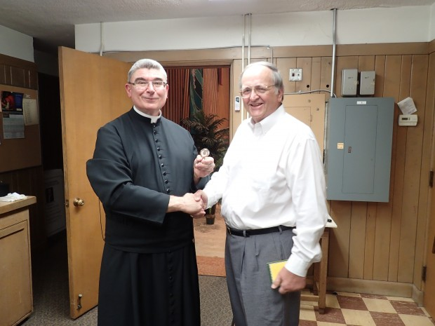 PLMC President Dr. Joseph Beierle presenting Fr. Cizik with a relic of St. Gerard Majella in appreciation of his support of the Traditional Latin Mass.