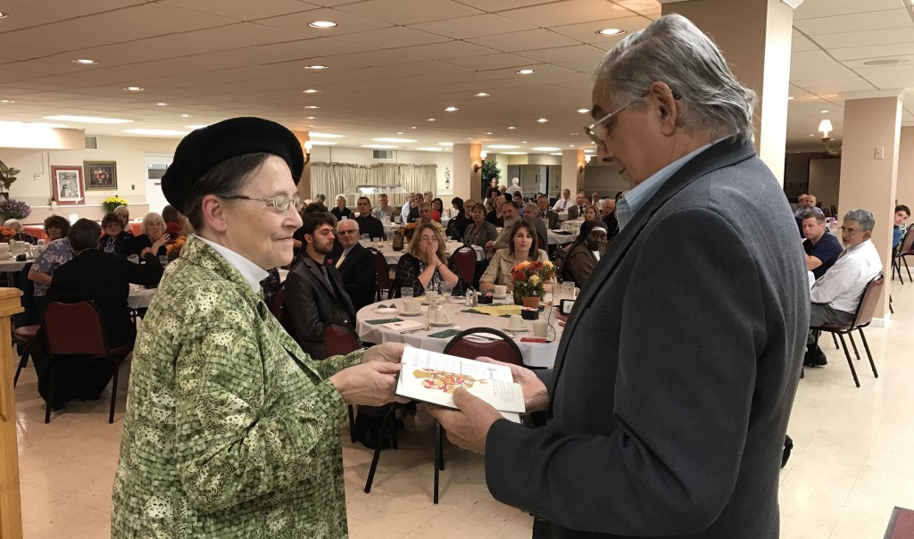 """""""There was a man sent from God whose name was John.""""  John 1:6P.L.M.C. Director, Cynthia Medvitz, presents a memorial gift to Sam Belli, Grand Knight of the Knights of Columbus Woodlawn Council 2161 on the occasion of the ninth consecutive Battle of Lepanto Seminar and Dinner.The gift was a leather bound, 1st edition volume of a scholarly boy biography entitled:""""The Lion and The CrescentThe Life of Don John of Austria""""by Margaret Yeo."""